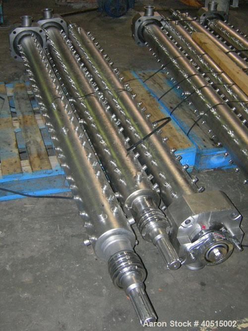 Used- APV Vertical Scraped Surface Heat Exchanger System, 316 stainless steel. Consisting of: (2) APV scraped surface heat e...