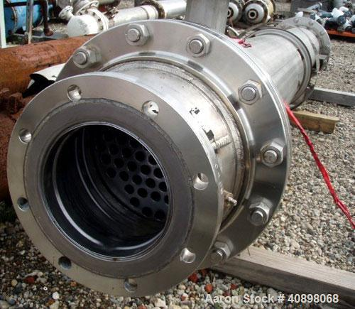Used- AstroCosmo Shell and Tube Heat Exchanger, 150 square feet , horizontal.Tantalum tubes, tube sheets and bonnets with (8...