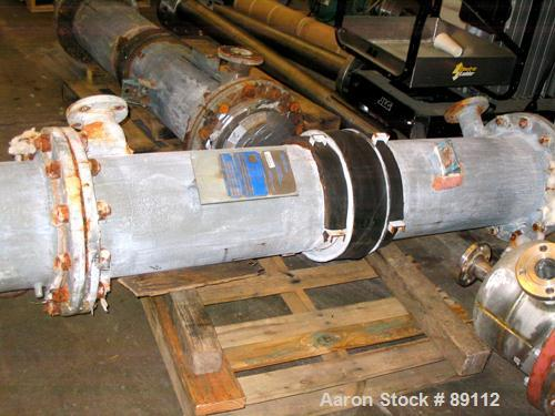 USED: Astrocosmos shell and tube heat exchanger, 123 square feet, vertical. Carbon steel shell rated 150 psi/FV at 400 deg F...