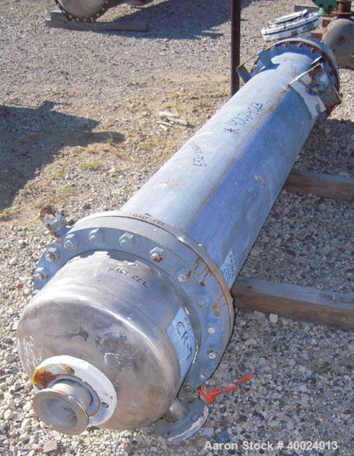 Used- Atlas Shell And Tube Heat Exchanger, approximately 234 square feet, vertical. Carbon steel shell rated 100 psi at 300 ...
