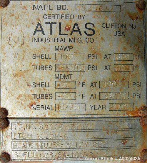 Used: Atlas shell and tube heat exchanger, approx 154 square feet, vertical. Carbon steel shell rated 100 psi at 300 deg.f.,...