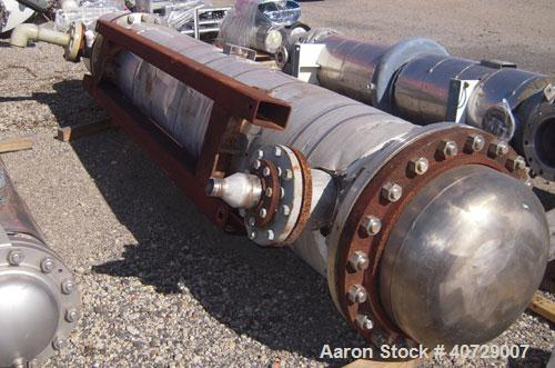 Used- Horizontal Futura Titanium Corp 2 Pass Shell and Tube Heat Exchanger, 1143 square feet, type BEM 24-2-144