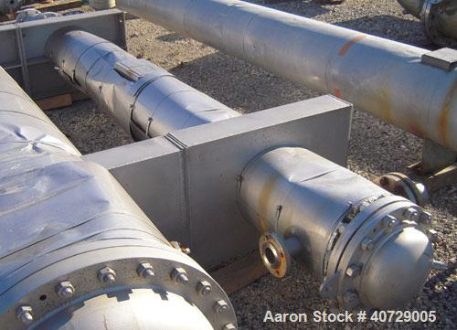Used- RAS Process Equipment 2 Pass Shell and Tube Heat Exchanger, 193 square feet, horizontal, type BEM 10-144. 316L stainle...