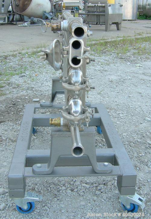 "Used- Tubular Heat Exchanger, approximately 12 square feet, copper nickel C710/80-20 construction. 1 1/2"" diameter pipe, (6)..."