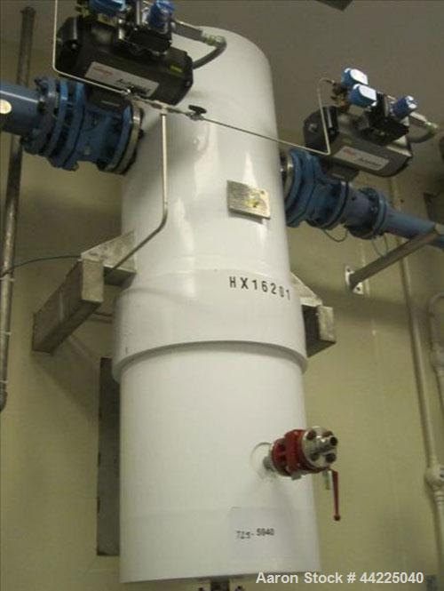 "Used- Doyle & Roth Vertical Heat Exchanger, 125 Square Feet, Model VT1661-3VE. (212) 3/4"" Diameter x 36"" long Hastelloy C276..."