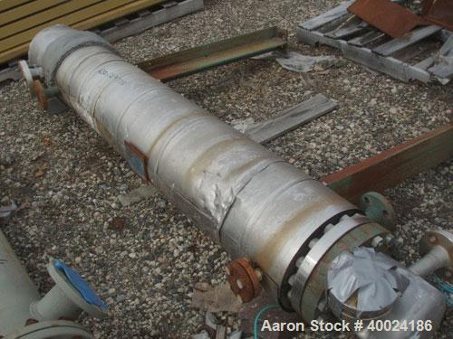Used- Yula Corporation Shell And Tube Heat Exchanger, 49 square feet, horizontal, model WC-1C-72BS. Carbon steel shell rated...