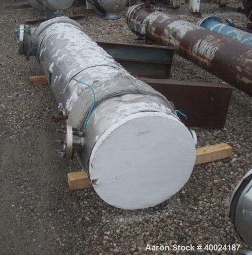 Used- Yula Corporation Shell and Tube Heat Exchanger, 299 square feet, horizontal, model WC-1H-96BS. Carbon steel shell rate...