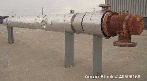 Used- Mueller Shell and Tube Heat Exchanger, 250 square feet, horizontal. Carbon steel shell rated 125 psi at 600 deg F and ...
