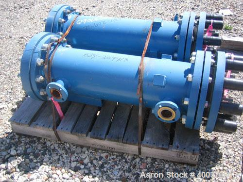 Used- SGL Carbon Group Cylindrical Block Graphite Heat Exchanger. Approximately 25 square feet, vertical, model CK2. Service...