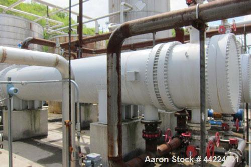 Used-Heat Exchanger, 4280 Square Feet, 4 pass shell and tube, horizontal.  Carbon steel shell rated 75 psi at 300 deg F.  (1...