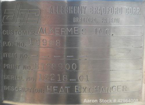 "Used- Allegheny Bradford Shell and Tube Heat Exchanger, 20 square feet, 316 stainless steel, vertical. (26) 7/8"" Diameter x ..."
