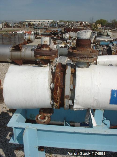USED: Ametek two pass U-tube heat exchanger, 22 square feet, size 1-R-1, horizontal. Carbon steel shell rated 150 psi at 500...