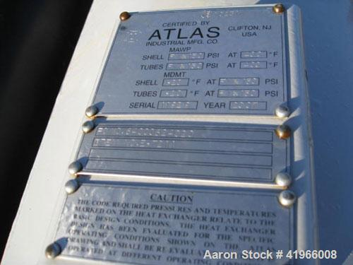 Unused- Atlas Industrial 4 Pass Shell and Tube Heat Exchanger, 1180 square feet, horizontal, type BEM 28-120. Carbon steel s...