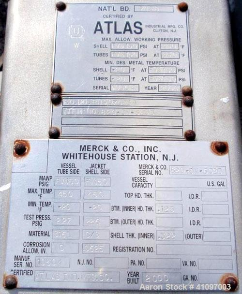 Used- Atlas Industrial Shell and Tube Heat Exchanger, 43 square feet, vertical. Carbon steel shell rated full vaccum and 150...
