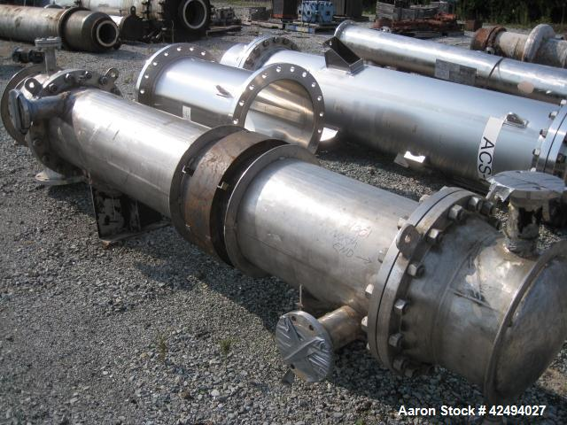 Used- Atlas Heat shell and tube exchanger, 403 square feet. 316L stainless steel tubes, tube sheets, shell and bonnets, with...