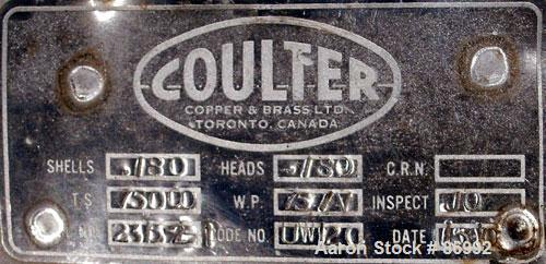 """Used- Coulter Shell and Tube Heat Exchanger, approximately 88 square feet. Stainless steel shell rated 75 psi, (90) 3/4"""" dia..."""