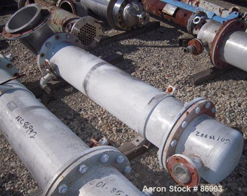 """Used- Coulter Shell and Tube Heat Exchanger, approximately 88 square feet. Stainless steel shell rated 60 psi, (90) 3/4"""" dia..."""