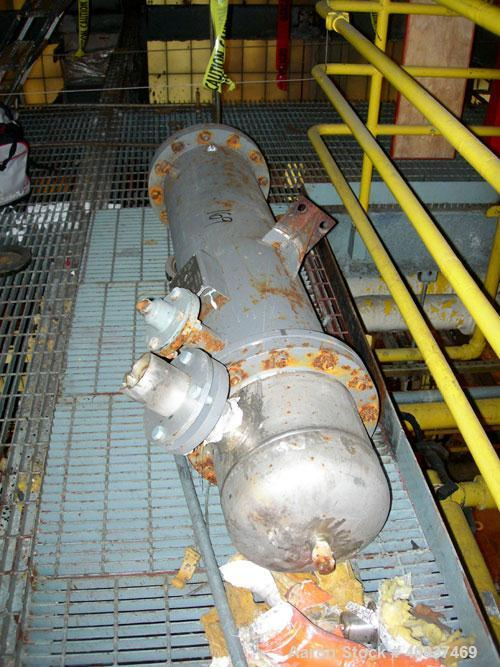 Used: Doyle and  Roth shell and tube heat exchanger, 98 square feet, vertical. Carbon steel shell rated 100 psi at 100 deg.f...