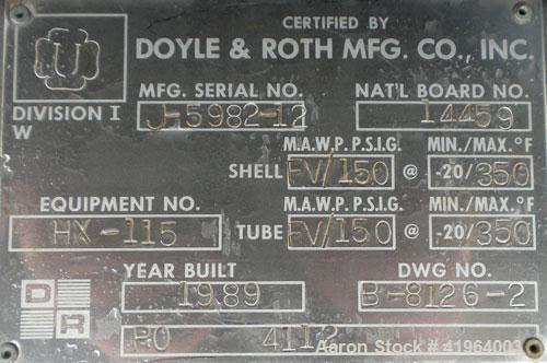 Used- Doyle & Roth Shell and Tube Heat Exchanger, 416 square feet, vertical. Carbon steel shell rated FV/150 psi at  –20/350...