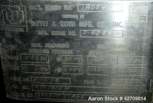 Used- Doyle & Roth Shell And Tube Heat Exchanger, 123 Square Feet, Vertical. Carbon steel shell rated 150 psi at –20/350 deg...