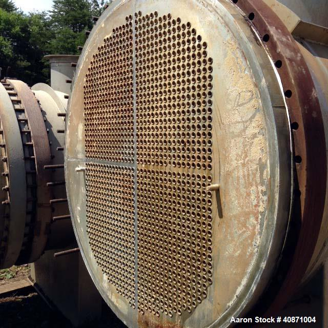 Used- Gaston County Dyeing Machine Multiple Pass Shell and Tube Heat Exchanger. Approximate 4550 square feet, horizontal. 30...