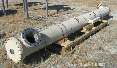 USED: Graham single pass shell and tube heat exchanger, 611 square feet, vertical. Carbon steel shell rated FV/20 psi at 150...