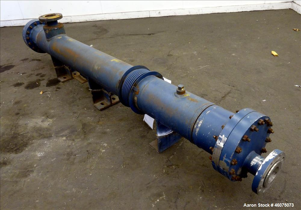 Used- ITT Industries Shell & Tube Heat Exchanger, Approximate 124 Square Feet, Horizontal. Carbon steel shell rated 100 psi ...