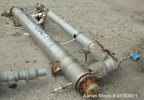 Used- J.D. Cousins Two Pass Shell & Tube Heat Exchanger, approximately 61 square feet, horizontal, model FS6144BEM. 316L Sta...