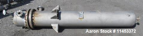 Used- 239 Square Foot Ketema Heat Exchanger. 316L stainless steel tubes, tube sheet, bonnet and shell. U tube design with (7...