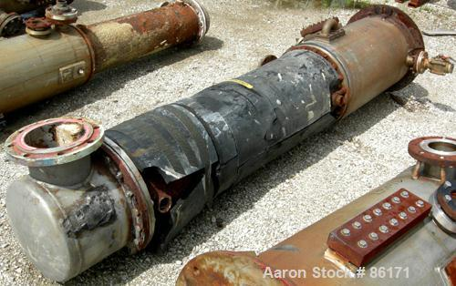 USED: Roben single pass shell and tube heat exchanger, 199 square feet, vertical. Carbon steel shell rated 100 psi at 212 de...