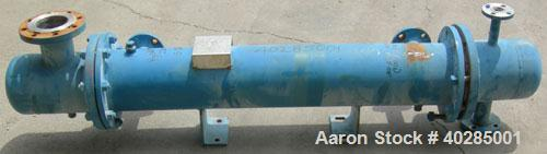 Used- Rubicon shell and tube heat exchanger, model VT8A1-48H, 48 square feet, horizontal. Carbon steel shell rated 150 psi a...