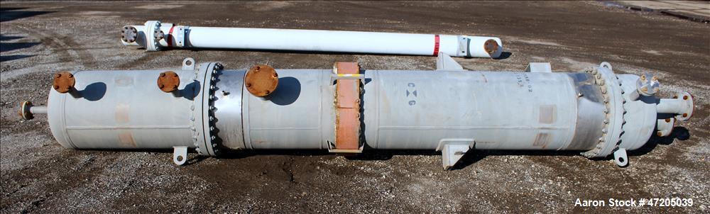 Unused- Steeltek 2 Pass Shell & Tube Heat Exchanger, 496 Square Feet, Type BEM, Size 23-9, Vertical. 304L Stainless Steel sh...