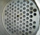 Used- Coulter Shell and Tube Heat Exchanger, approximately 88 square feet. Stainless steel shell rated 75 psi, (90) 3/4