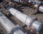 Used- Coulter Shell and Tube Heat Exchanger, approximately 88 square feet. Stainless steel shell rated 60 psi, (90) 3/4