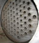 Used- Toronto Coppersmith Shell and Tube Heat Exchanger, approximately 150 square feet, stainless steel. Carbon steel shell ...