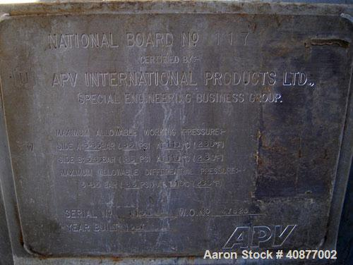 Used- APV International Limited Horizontal Spiral Heat Exchanger, Type 1. 2413 square feet, 316 stainless steel shell. Hot a...