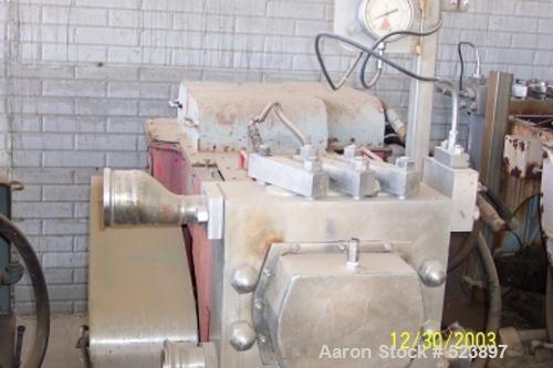 USED: Gaulin high pressure pump, model HCP18 1TPN, hydraulic motor, industrial frame.