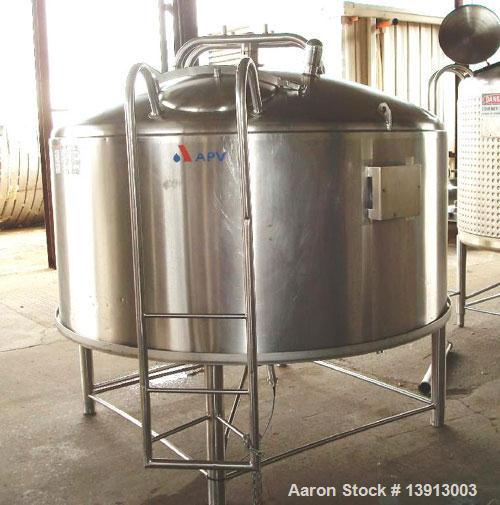 Unused-Used: APV 1000 gallon processor. 75 psi @ 350 deg jacket. Dome top with manway and cover, cone bottom with centr bott...