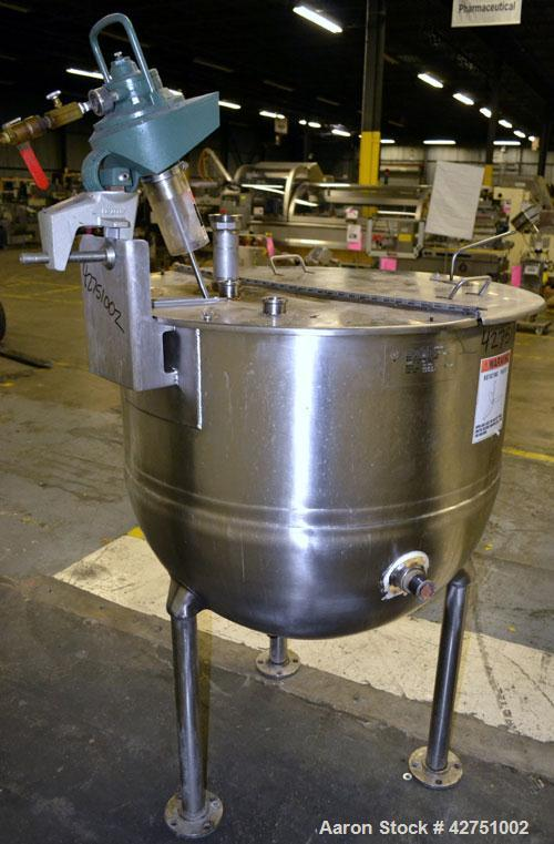 "Used- Groen Kettle, 100 Gallon, Model EN-100, 316 Stainless Steel. 36"" Diameter x 32"" deep. Open top a 1/2 hinged cover, jac..."