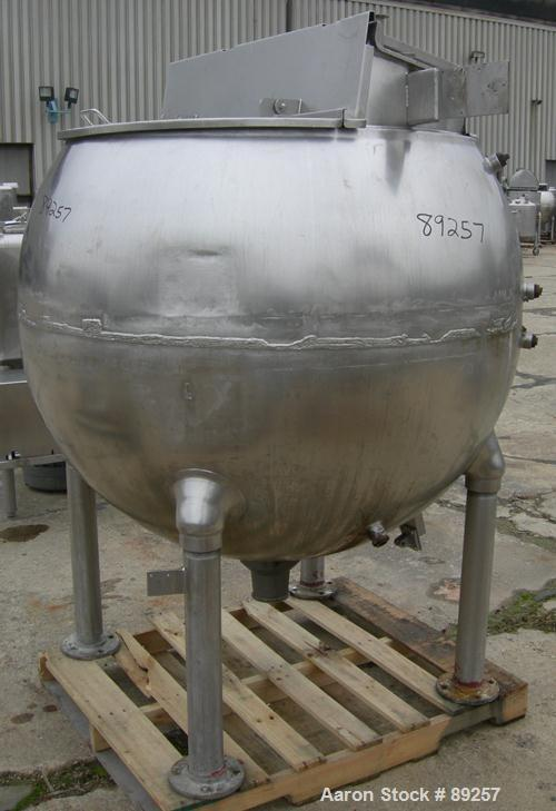 """USED: Groen inclined agitated kettle, 250 gallon, model INA/TA250, 316 stainless steel, vertical. Approximate 54"""" middle dia..."""