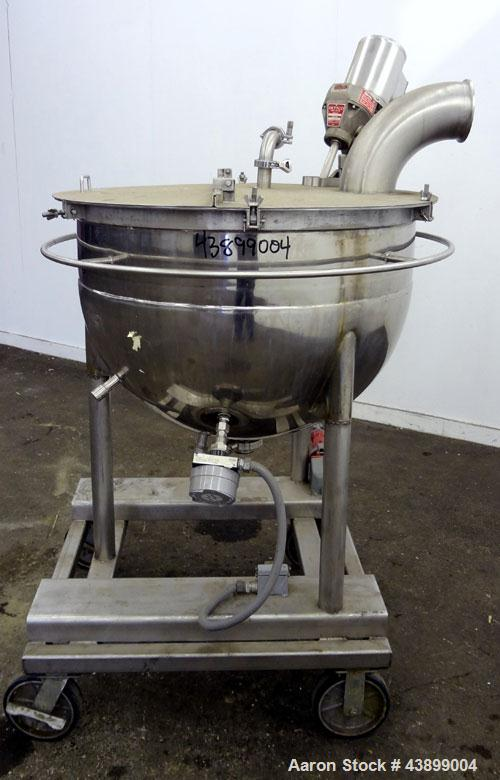 "Used- Lee Metal Products Kettle, 80 Gallon, 304 Stainless Steel. Approximate 36"" diameter x 24"" deep. Open top with a hinged..."