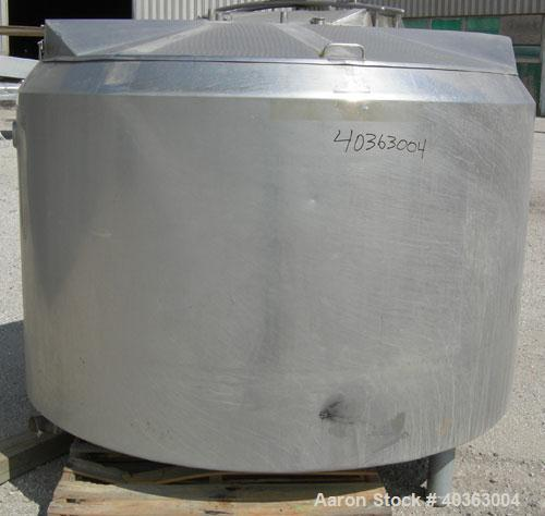 "Used- Kettle 550 Gallon, 304 stainless steel, vertical. Approximately 66"" diameter x 38"" straight side. Flat top with (2) 1/..."