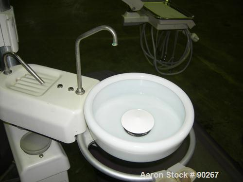 USED: A-Dec dental chair, model 1020. Foot pedal controls, A-Dec delivery system, cuspidor. Includes doctor and assistant st...