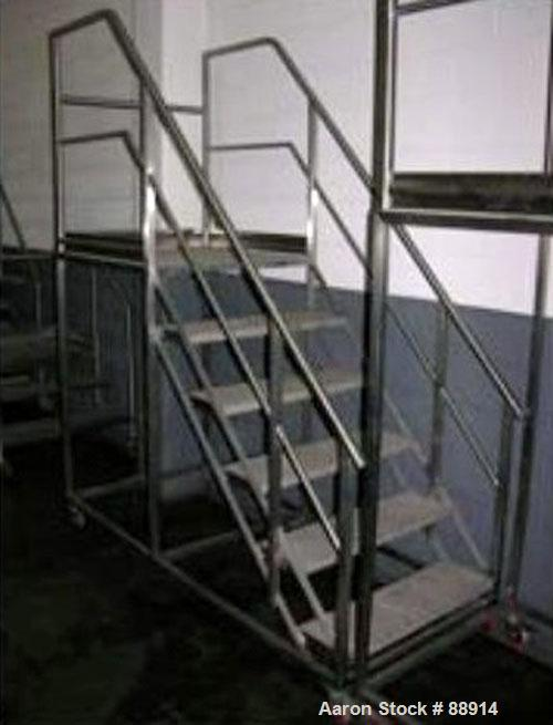 "Used- Set of Portable Stairs, Stainless Steel. 33"" wide x 56"" high, 6 steps. Mounted on casters."