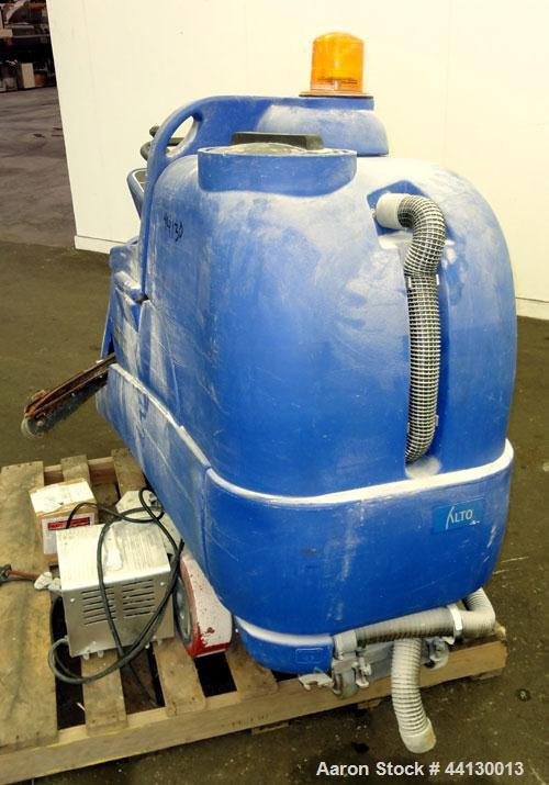 Used- Clarke Alto Mini-Max Rider Floor Scrubber. Includes a battery charger, no batteries. Built 2002.