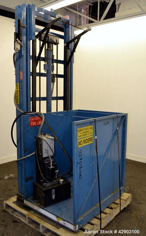 """Used- Florlift Elevator, 750 Pound Capacity, Carbon Steel. Approximate cradle dimensions 28-3/4"""" wide x 41"""" deep x 40"""" tall ..."""