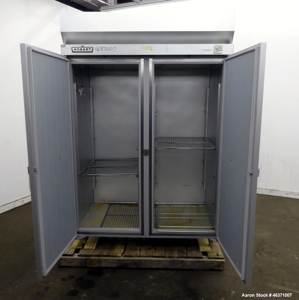 Used- Hobart Two Section Medium Temperature Refrigerator, Model Q2. 48.9 Cubic feet capacity, approximate interior dimension...