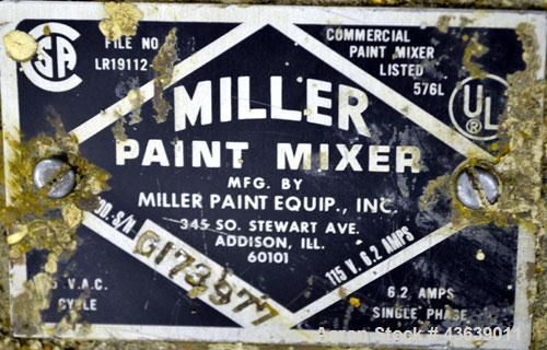 Used- Miller Dual Paint Shaker, Model G.  Dual canister holders, driven by an approximate 1/3hp motor.