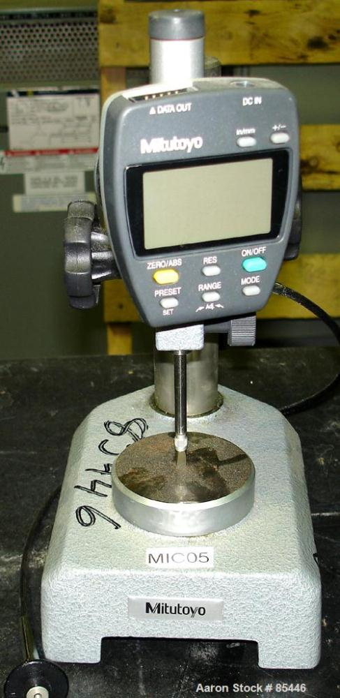 Used- Mitutoyo Digital Dial Gauge, Model ID-F125E. 9V, 500 mA DC power. Rated 25.4-0.001mm. Manually adjustable gauge height.