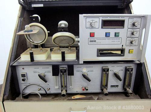 Used- Mocon Ox-Tran Twin Oxygen Permeation Measuring Machine, Part# 001-050. Includes a Mocon oxygen transmission rate datal...